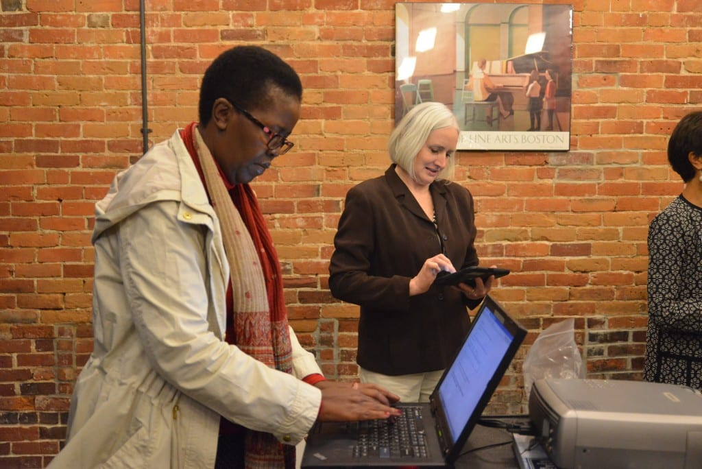 Dr. Lindiwe Majele Sibanda takes the opportunity to sign the Lewiston-Auburn Community Food Charter at the launch event. Individuals, businesses, organizations, municipalities and other groups are encouraged to sign the Food Charter at goodfood4la.org.
